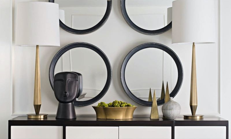 FlowDecor buffet lamps in brass on a black & white cabinet
