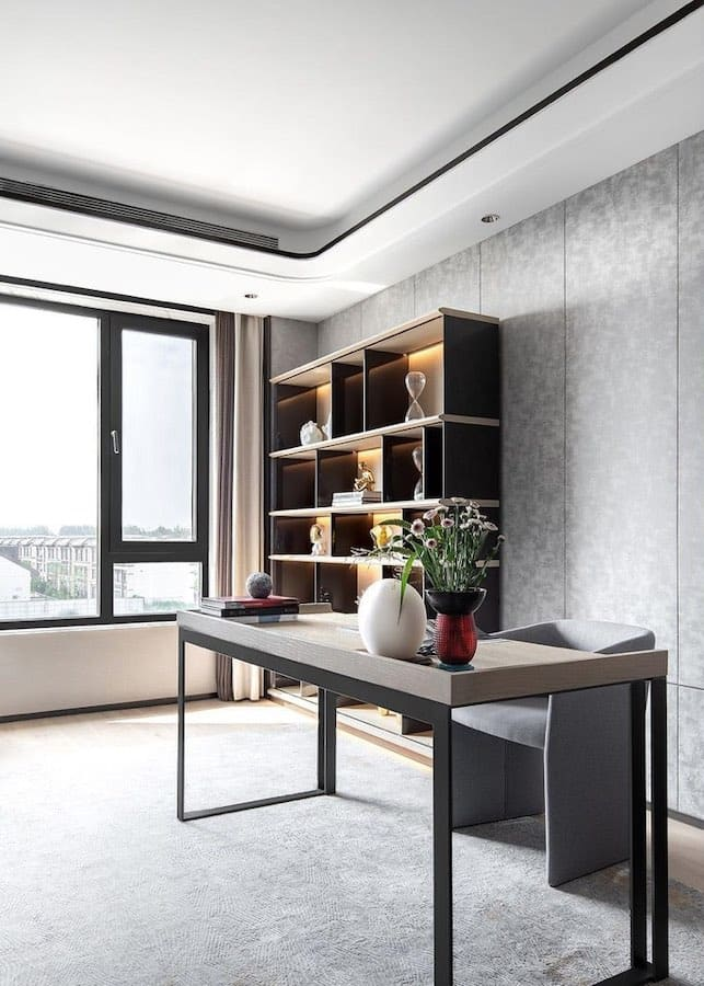 HC28 office room with elegant gray desk, a tub chair, and partitioned book shelf