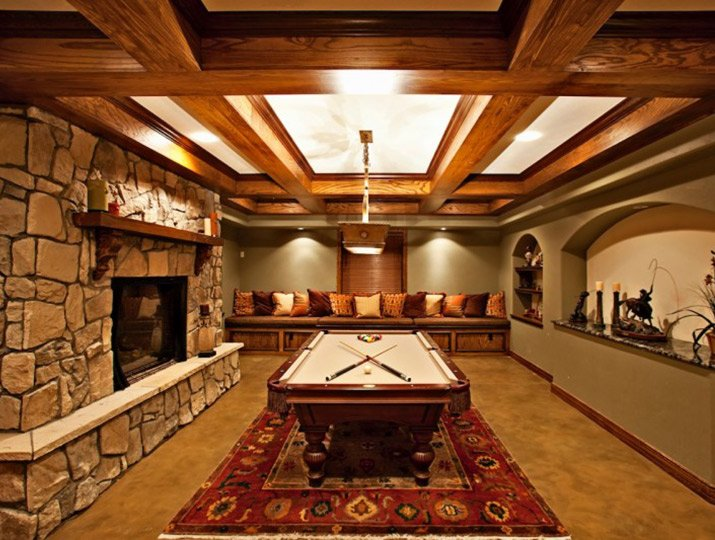 A billiards room with fireplace for a home in Greenwood Village