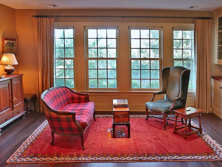 a warm red sitting area near windows, in the country, by Design Wright Studios