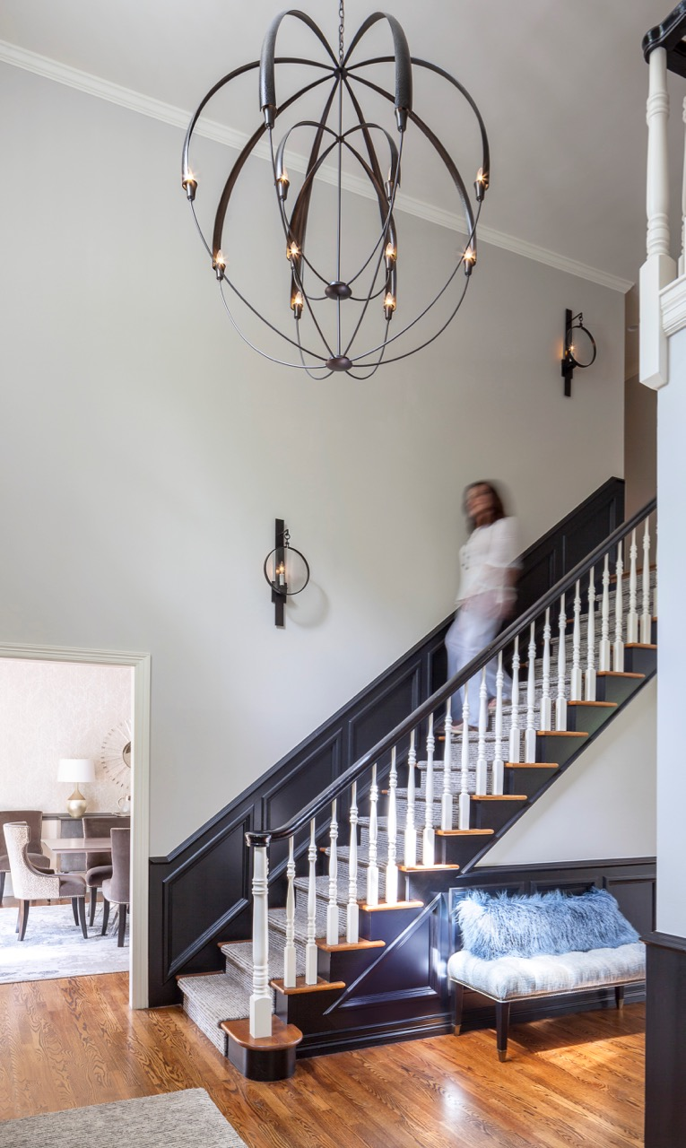 transitional entry with grand chandelier designed by Design Wright Studios
