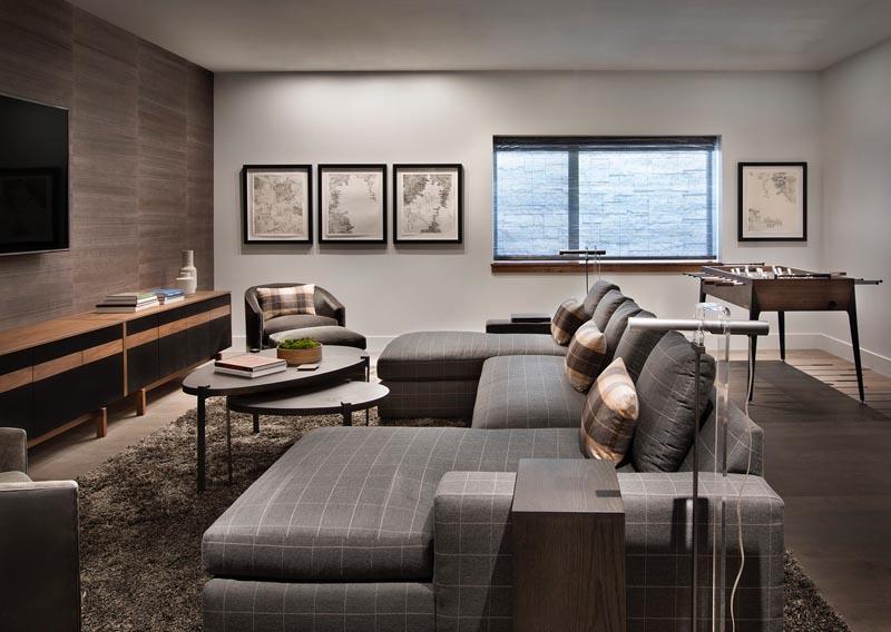DWS media room sofa in gray-brown, room design by Robyn Scott