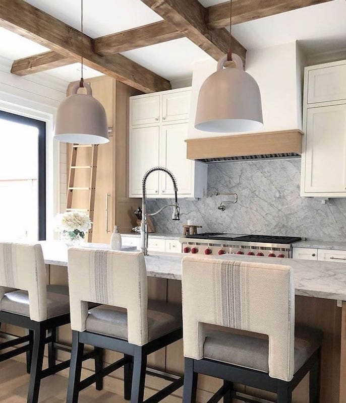 Modern kitchen with three upholstered bar stools (Peekaboo chairs) designed by Grace Simmering