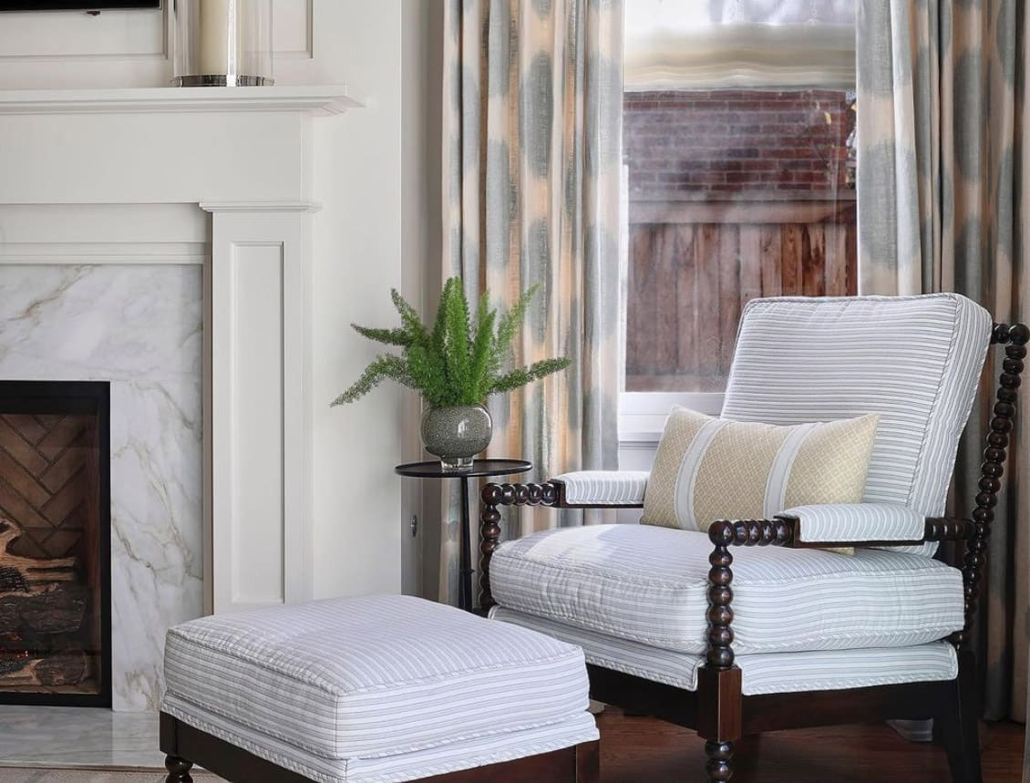Design Wright Studios' Yankee Spool Chair and ottoman in white upholstery with ivory pillow, design by Jess Knauf