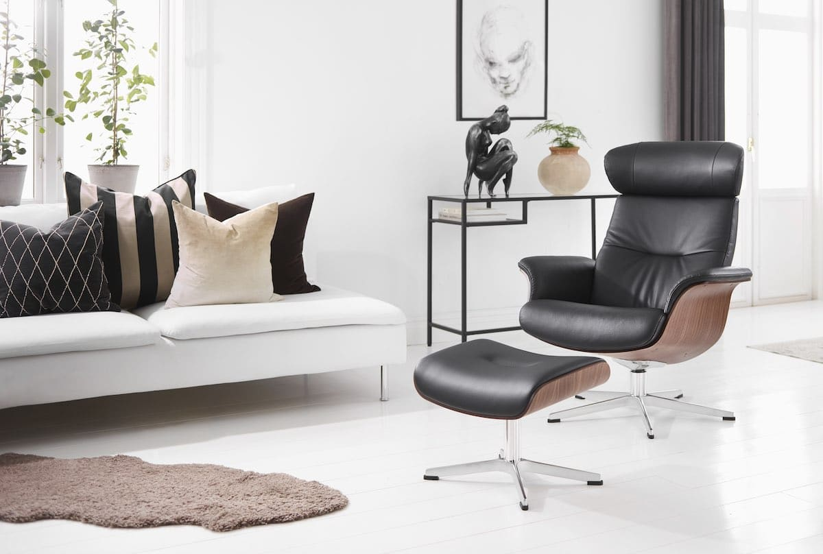 an ergonomic black leather Timeout chair and footrest, by Conform