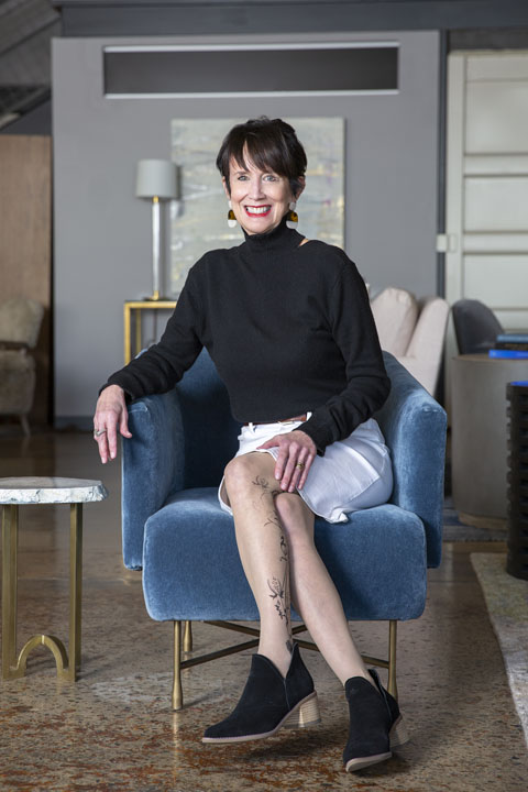 Mary Pat Heath smiling in a blue chair