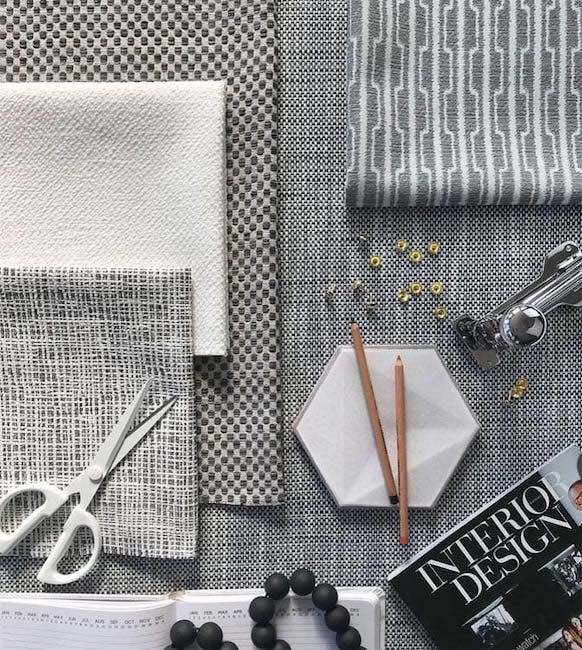 mood board with gray, taupe, white and black textured fabrics